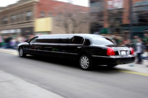 Photo of a limousine driving in the city.