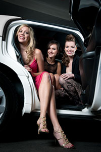 Photo of three women in a limousine