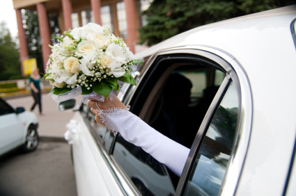 wedding limousine and brides bouquet
