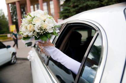 wedding limousine and brides bouquet