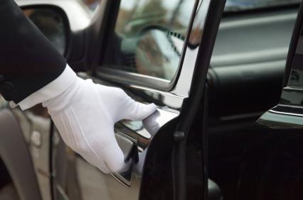 Driver opening limo door