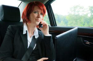 Businesswoman in a limousine